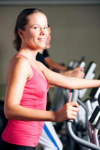 people-exercising-elliptical-trainer-gym